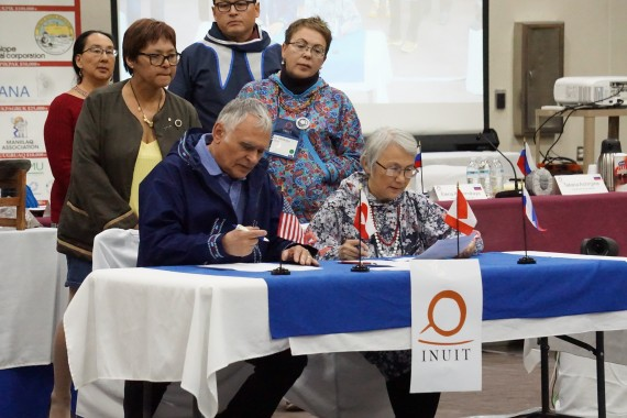 Jimmy Stotts of ICC Alaska and Tatiania Achirginia of ICC Chukotka sign Utqiagvik Declaration. (PHOTO COURTESY OF YERETH ROSEN/ARCTIC TODAY)