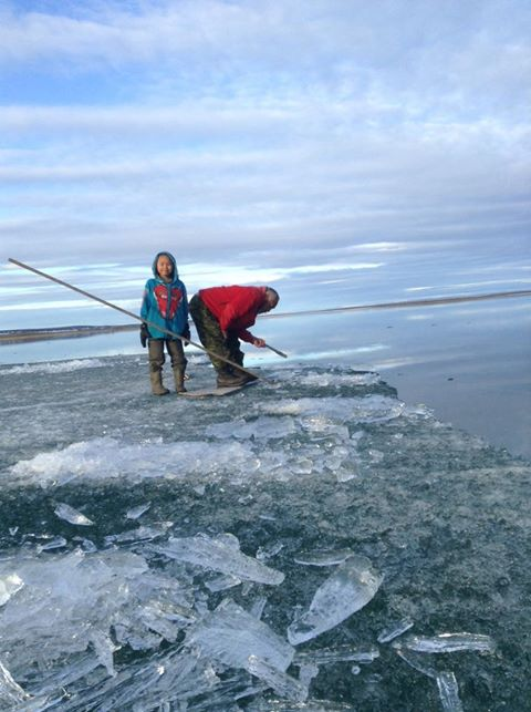 Panik Ruthannrose Ukuqtunnuaq shared this photo of her son William Blake Ukuqtunnuaq (left) and Daniel Ukuqtunnuaq fishing in Netsilik last month. (PHOTO BY PANIK RUTHANNROSE UKUQTUNNUAQ)
