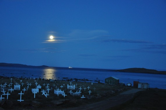 The full moon illuminates Iqaluit's municipal cemetery on July 28. The lights of a passing Coast Guard ship can also be seen. (PHOTO BY SARAH ROGERS)