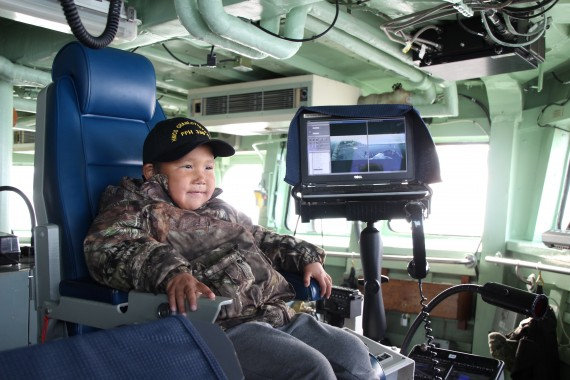 Samson Akeeagok, 6, mans the captain's chair on board HMCS Charlottetown, while the naval ship anchors in Frobisher Bay on Aug. 27.  (PHOTO BY BETH BROWN)