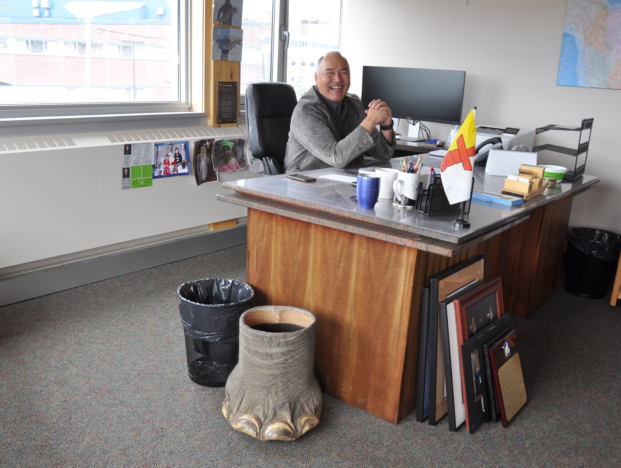Nunavut Premier Joe Savikataaq sits at his desk in his office on the top floor of the legislative assembly building in Iqaluit. Next to his desk sits one of his hunting trophies, a wastebasket made from an elephant hunted by his son, Joe Jr., on a hunting safari the pair went on in Zimbabwe. (PHOTO BY SARAH ROGERS)