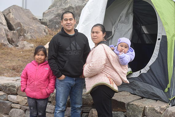 This family of four pitched a tent outside the legislative assembly in Iqaluit on the evening of Monday, Sept. 24. They say they're running out of couch-surfing options this winter, and they intend to keep sleeping in their tent until they're offered a spot with public housing. (PHOTO BY COURTNEY EDGAR)