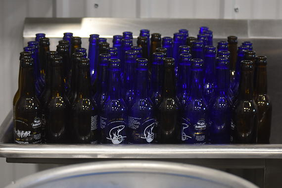 Nu Brew has a plan to re-use its glass bottles. The company plans to pick up empties once a week from the city's bars and restaurants. (PHOTO BY COURTNEY EDGAR)