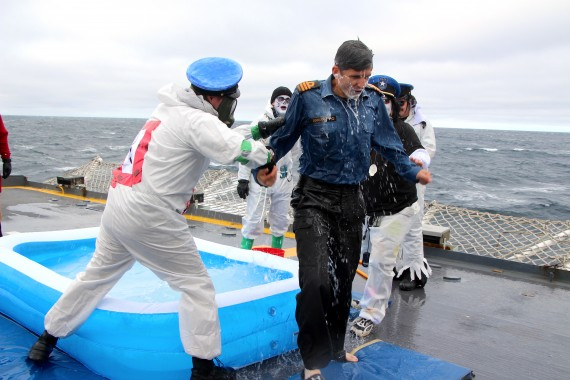 Commander Nathan Decicco gets baptized last as part of a crossing-the-line tradition. (PHOTO BY BETH BROWN)
