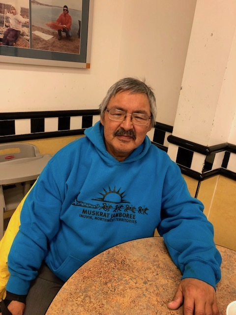 Grieving father Bobby Epikghout Ekpakohak sits in the Pizza Hut in Cambridge Bay with a coffee as he talks about his son, Adam, who died Sept. 24. (PHOTO BY JANE GEORGE)