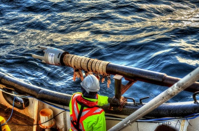 IT Telecom crew members prepare to launch what's called the Gravity Corer off its vessel; the tool is used to collect seabed core samples. (PHOTO COURTESY OF IT TELECOM)