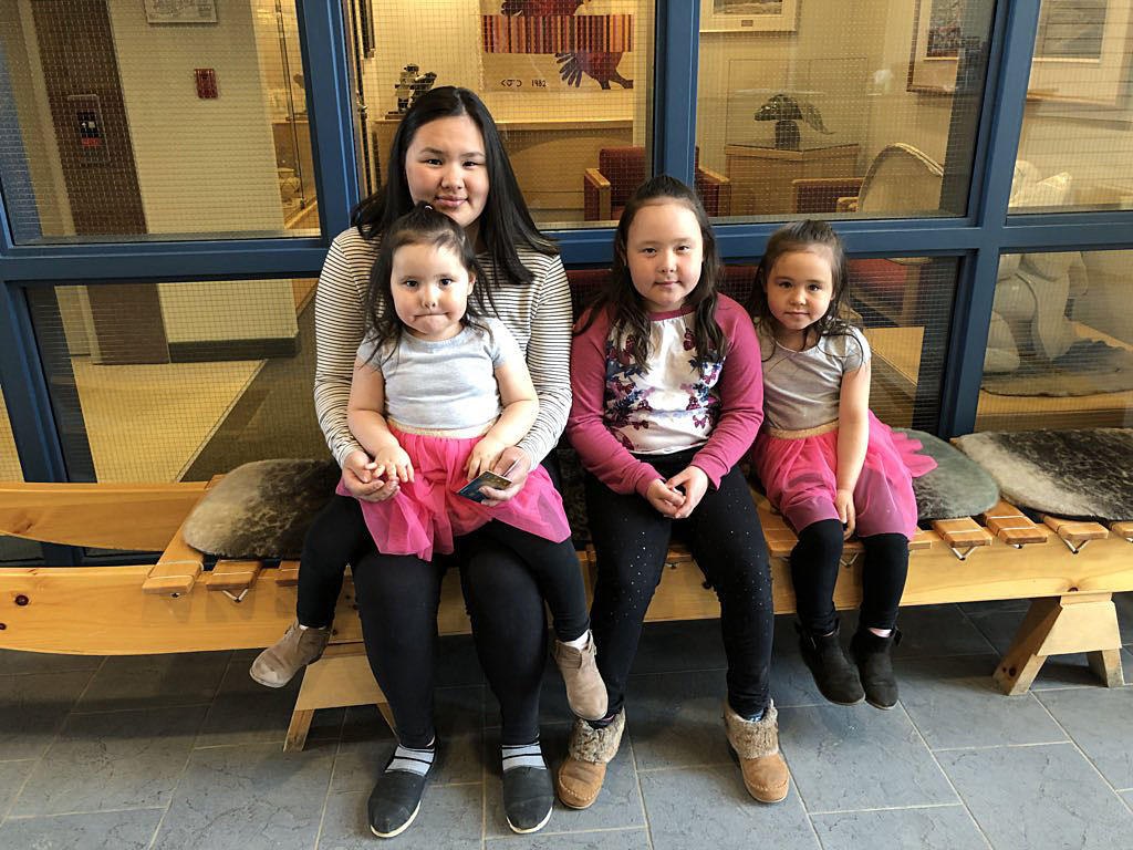 The daughters of Kugluktuk MLA Mila Kamingoak visit their mom at work in the legislative assembly this past June 13. Speaker Joe Enook has named members to a commission that will look at how to make MLAs' pay packages more family-friendly. (FILE PHOTO)