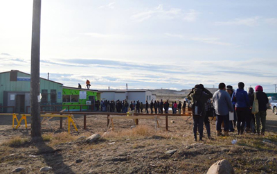 Iqaluit residents line up at the city's cold beer and wine store, which opened one year ago on Sept. 6. The Government of Nunavut is looking for feedback from the public on the pilot project. An online survey is available until Sept. 28 and a paper survey can also be filled out in person at the store. (FILE PHOTO)