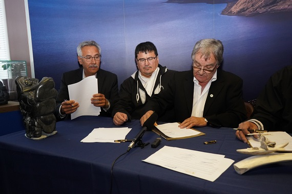 From left, First Air chairperson Johnny Adams, Inuvialuit Regional Corp. chair Duane Smith, and Makivik Corp. President Charlie Watt, in Montreal on Sept. 28, signing an agreement to merge First Air and Canadian North into one pan-Arctic airline. (PHOTO COURTESY OF MAKIVIK)