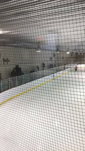 A view from behind the protective netting that surrounds the hockey rink in Puvirnituq. After a Nunavik girl died from being struck in the head by a hockey puck, a coroner's report recommends the Quebec government look at the effectiveness of protective netting in arenas across the province. (FILE PHOTO)