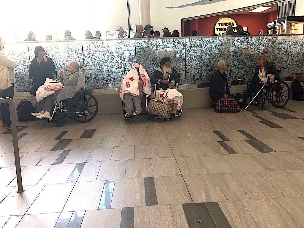 Elderly passengers off British Airways flight 103 are wrapped in Red Cross blankets, as they sit in wheelchairs Sept. 13 in the terminal of the Iqaluit airport where they wait for their flight on to Calgary. (PHOTO BY FRANK REARDON)