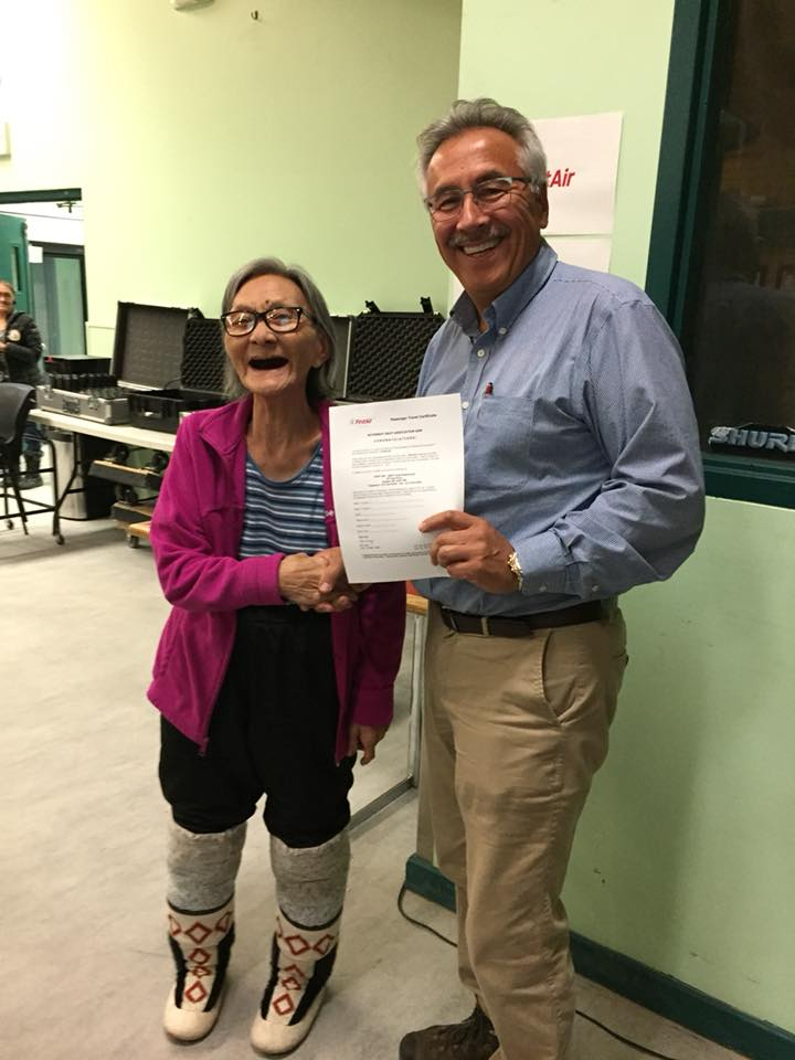 First Air's chairman Johnny Adams stands with Susie Konana, an elder from Gjoa Haven, who won a flight certificate in a draw, Oct. 18, at the Kitikmeot Inuit Association's annual general meeting in Cambridge Bay. (PHOTO COURTESY OF FIRST AIR)