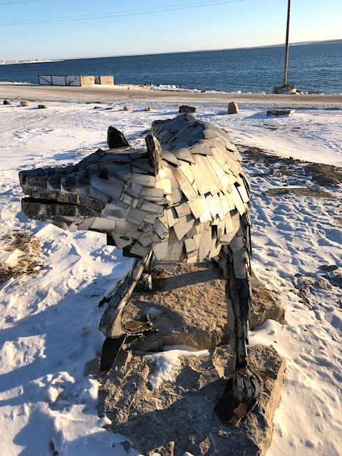 From Scrap to Art is a Cambridge Bay–based project, shortlisted for an Arctic Inspiration Prize, that would see young welders using scrap metal to build on their skills and create works of art, such as this wolf made of scrap metal behind the Cambridge Bay municipal office. (PHOTO BY JANE GEORGE)