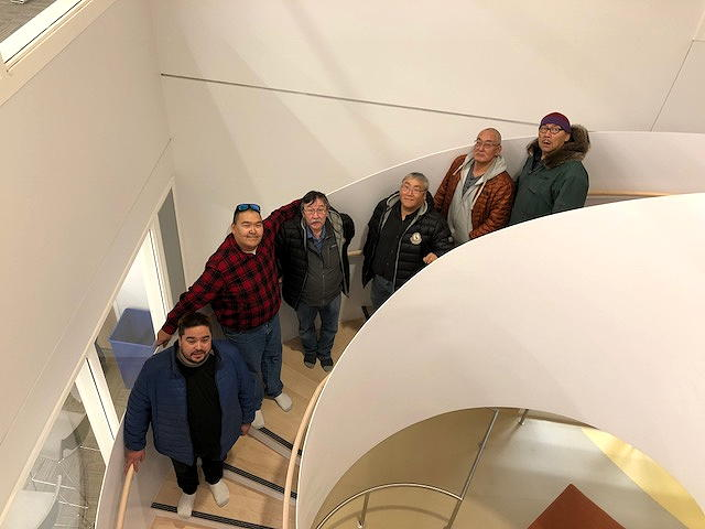 Members of the Kitikmeot Inuit Association's board stand on a staircase in the Canadian High Arctic Research Station in Cambridge Bay during a tour of the facility last month. During the KIA's annual general meeting, delegates asked for health to be one of the new focuses of research undertaken at the centre. Find out what research is—and isn't—being done at CHARS, which remains officially closed, on nunatsiaq.com. (PHOTO BY JANE GEORGE)