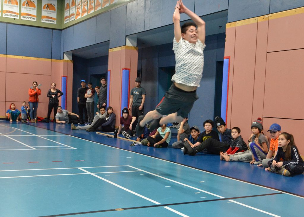 Aloupa Watt tries out in the triple jump in Kuujjuaq, Nunavik