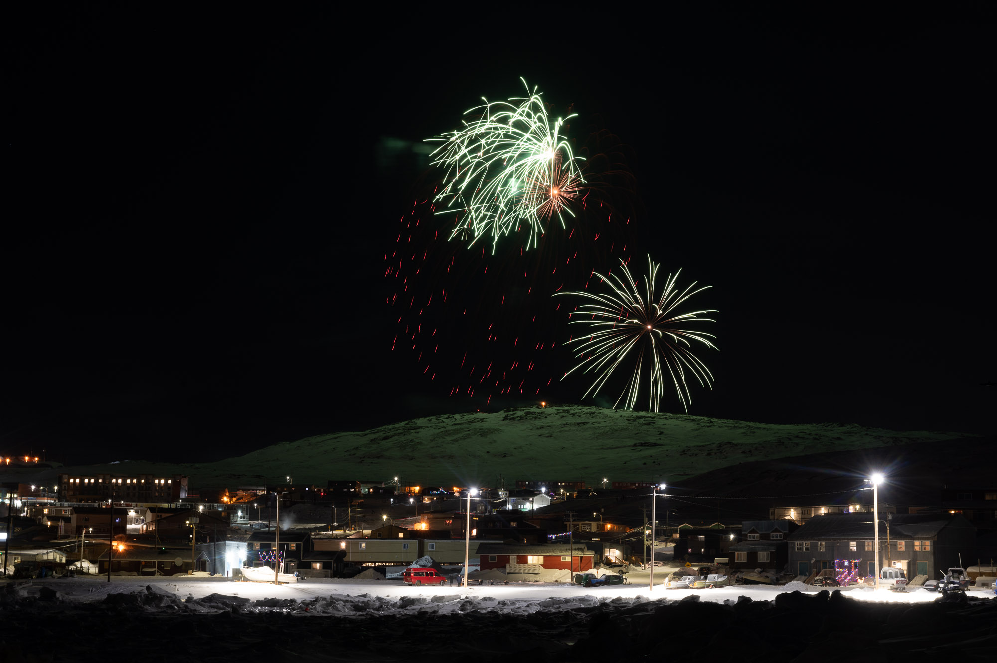 Iqaluit rang in 2021 with two New Year's Eve fireworks displays from the top of Hospital Hill. Organizers 123 Go! dedicated the shows to the memory of elder Inookie Adamie, who died in September at the age of 109. (Photo by Dustin Patar)