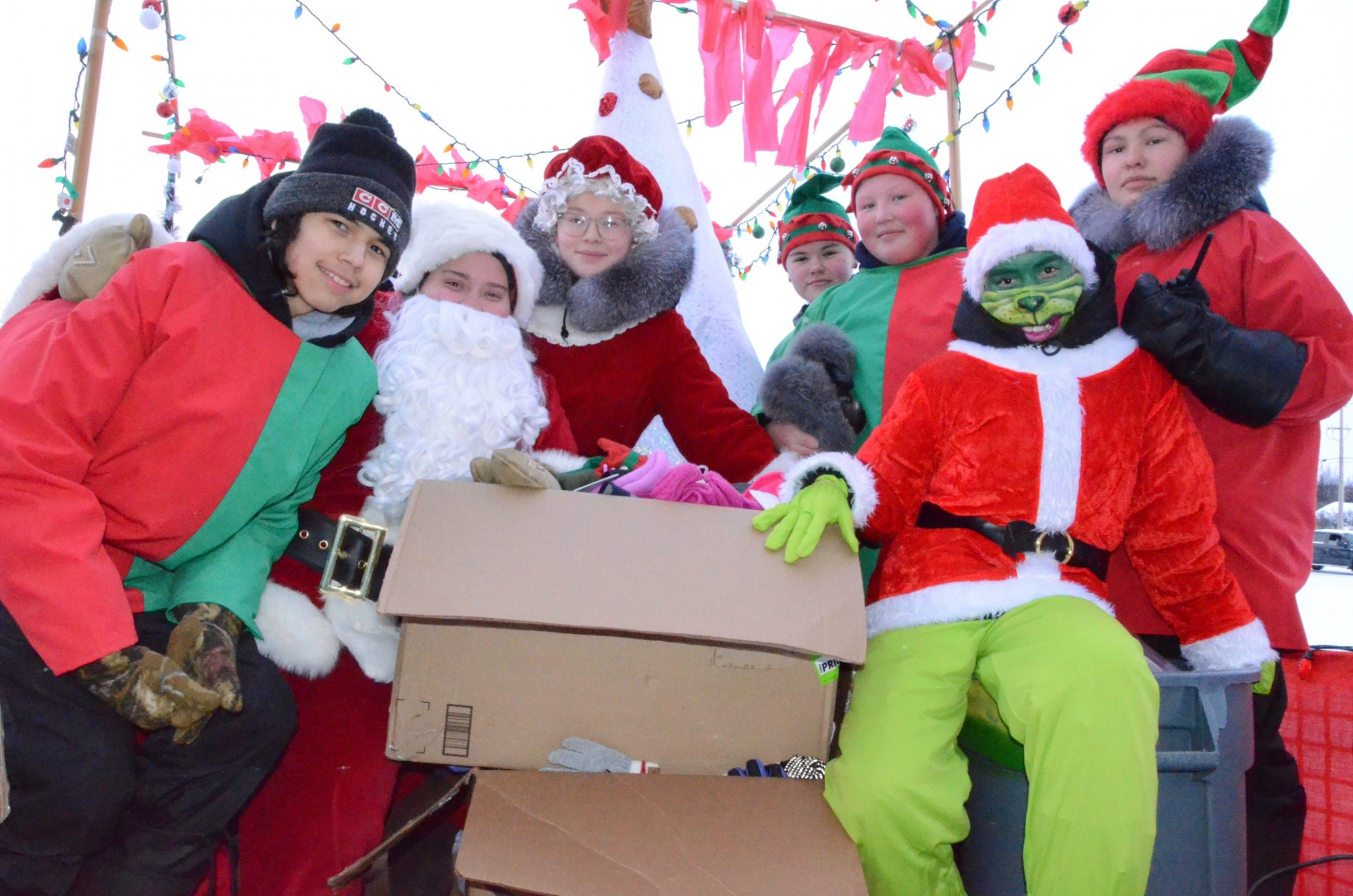 Santa Claus, his helpers and the Grinch paid a visit to Kuujjuaq on Sunday, Dec. 20. (Photo by Isabelle Dubois)