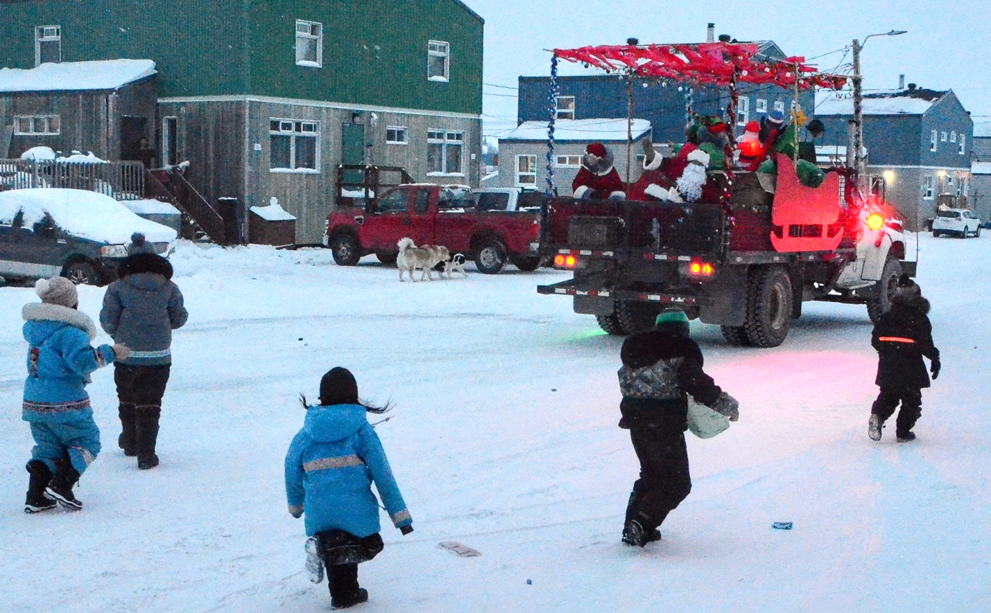 Santa Claus and his helpers distribute candies and other presents — such as hats, gloves and mitts — during a tour around Kuujjuaq on a municipal flat bed truck dubbed Rudolph on Sunday, Dec. 20. (Photo by Isabelle Dubois)