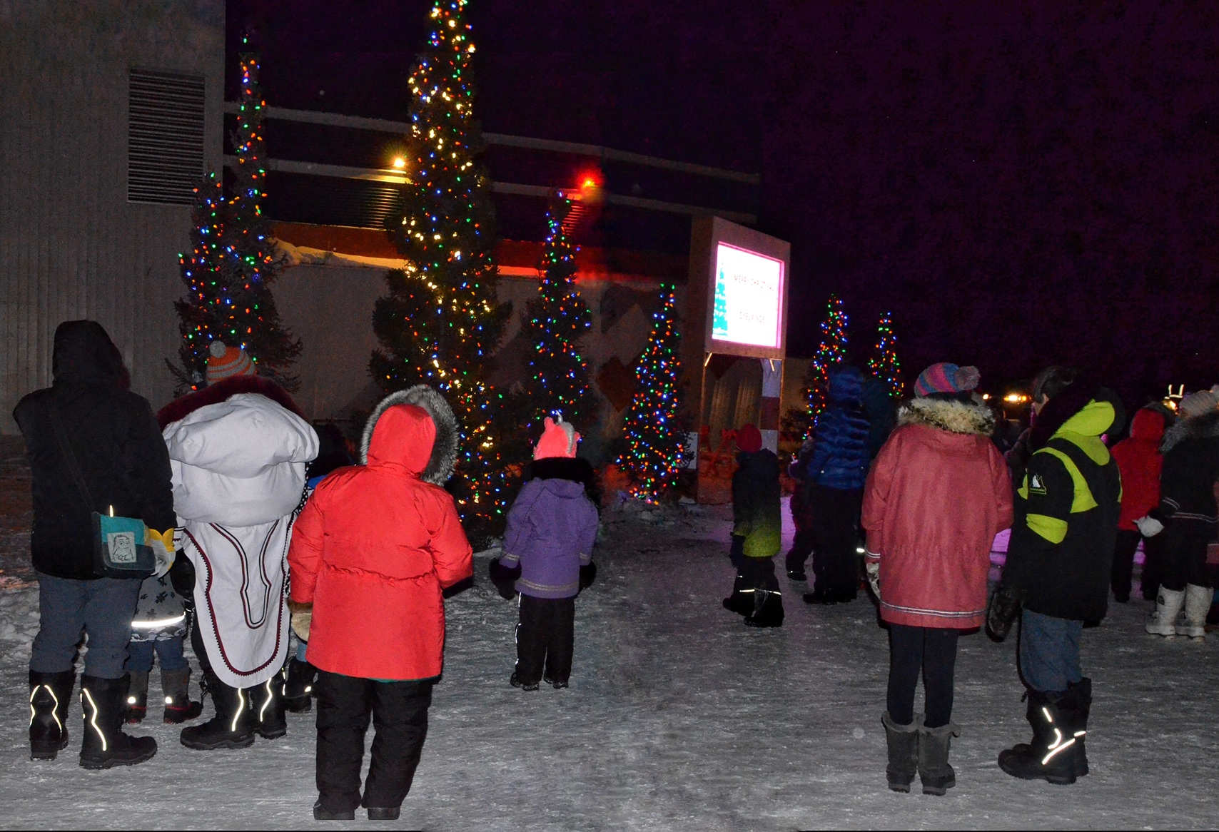 Kuujjuaq residents gather in front of the northern village office for the lighting of Christmas trees on Dec. 21. (Photo by Isabelle Dubois)