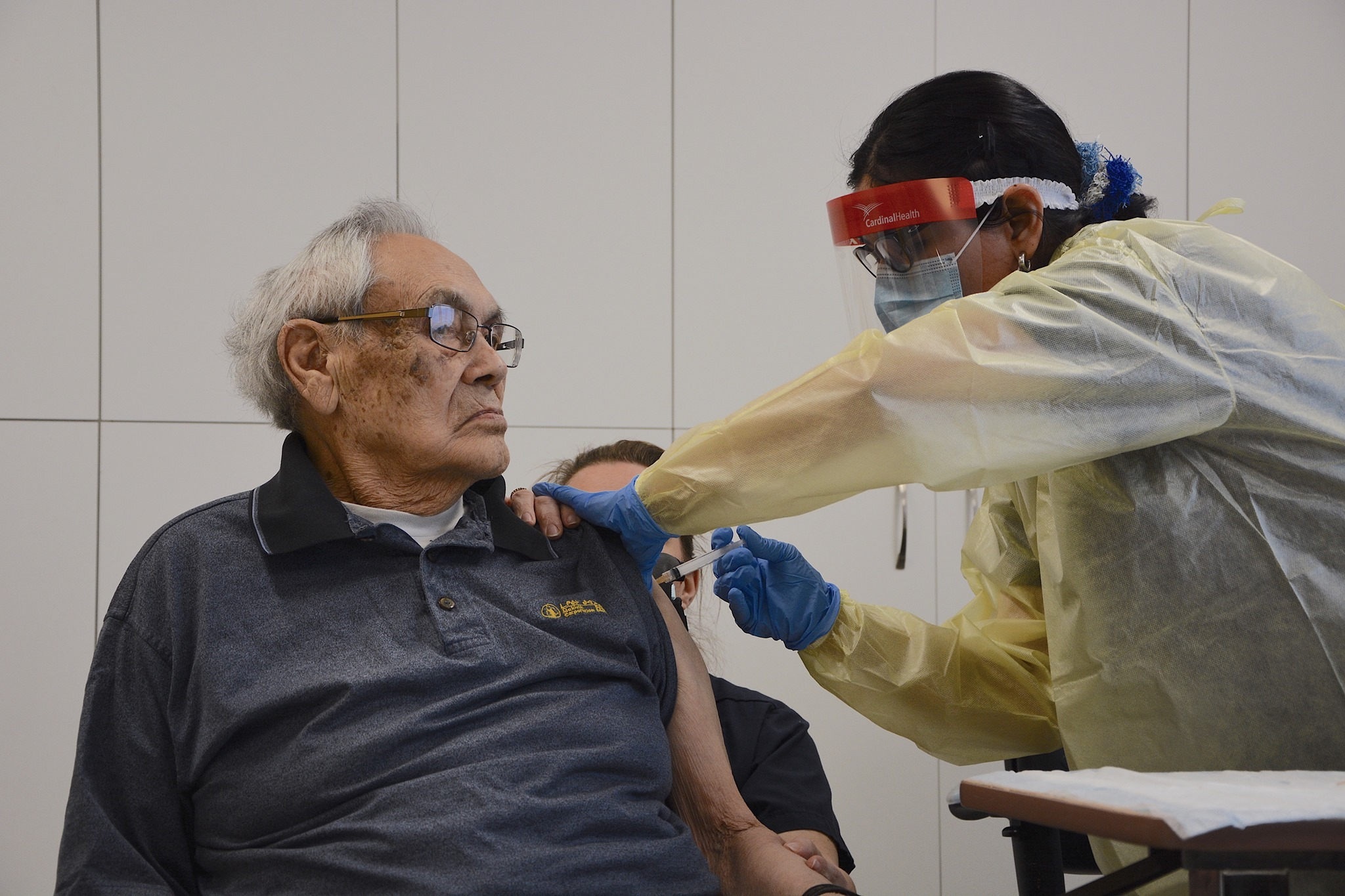 Johnny Watt, a resident of Tusajiapik Elders' Home in Kuujjuaq, was the first person in Nunavik to be vaccinated against COVID-19 on Sunday, Jan. 17. Watt has a history with vaccines: he helped deliver the measles vaccines to camps by dogsled team in the early 1950s. Nunavik received its first batch of 1,000 doses of Moderna's vaccine this past weekend. Immunization will begin in the region's other communities this week. (Photo courtesy of the NRBHSS)