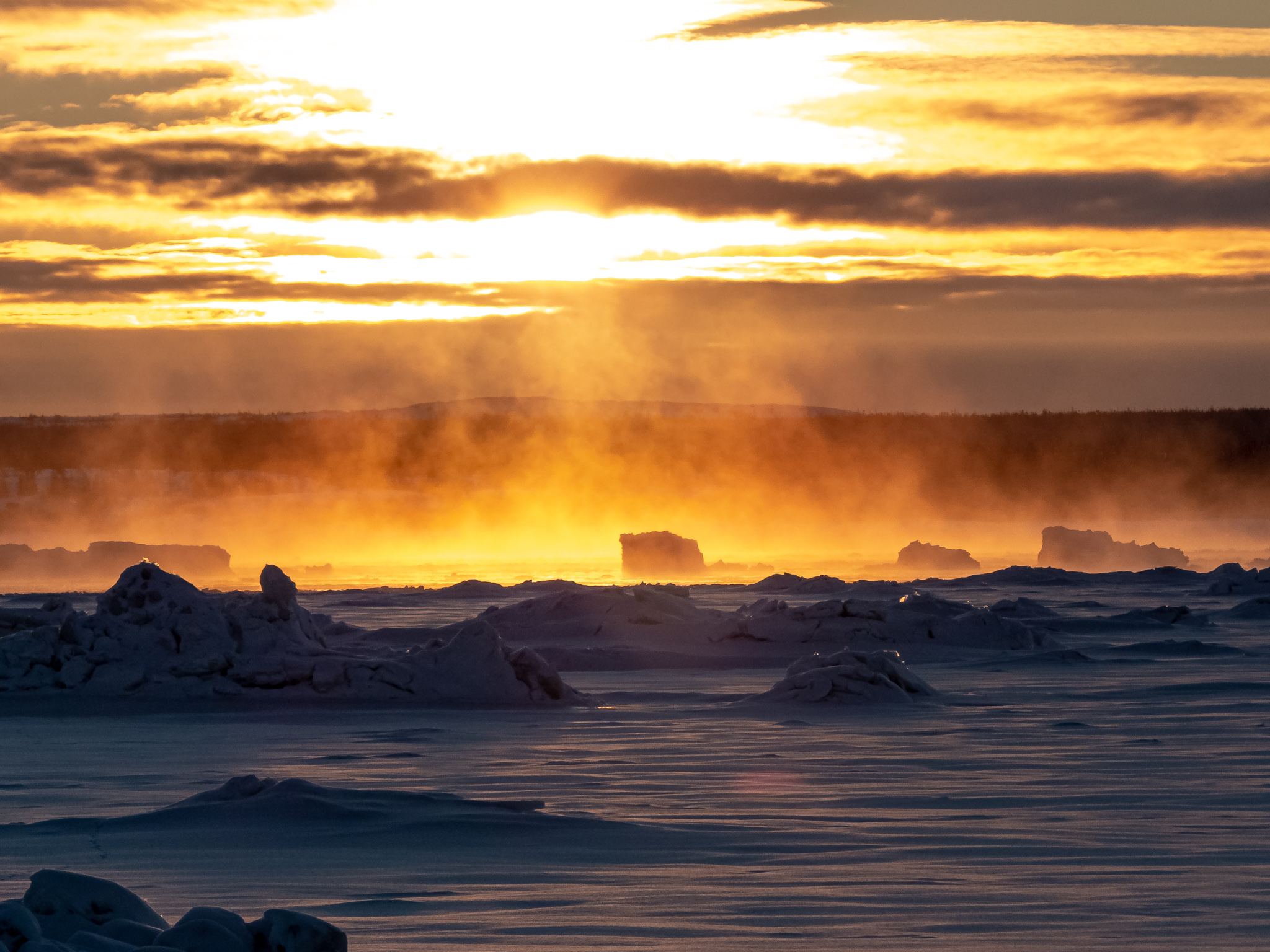 """Water vapour rises off the Koksoak River in Kuujjuaq at sunrise around 8 a.m. on Jan. 22. """"The water, which has not yet frozen, and the smoke are reflected like a river of lava surrounding the icebergs,"""" writes photographer Maxence Chavanne. (Photo by Maxence Chavanne)"""