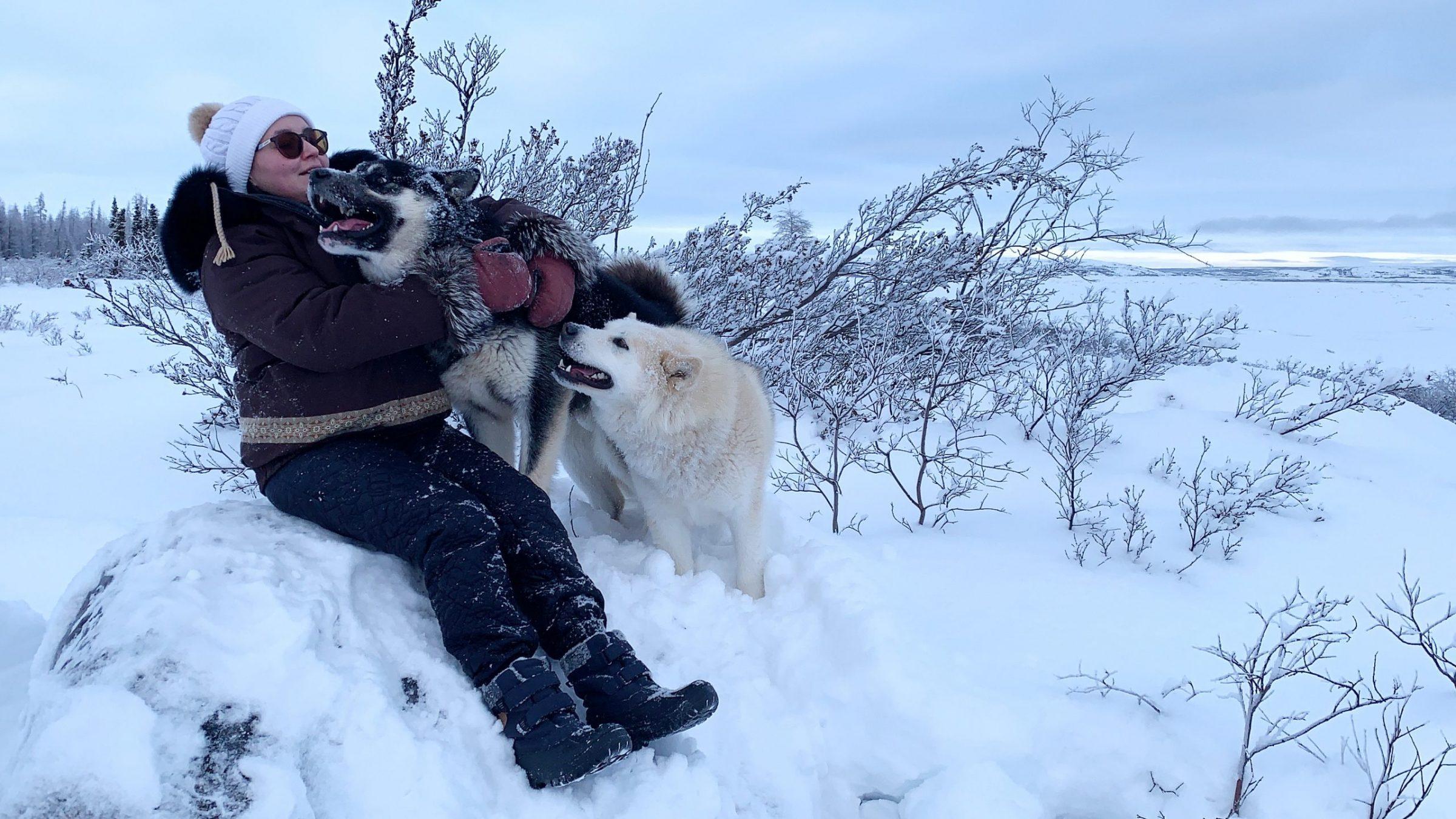 Lavinia Flaherty of Kuujjuaq takes her two huskies, Chubby and Hunter, for a walk and snuggle Jan 26. (Photo by Malaya Qaunirq Chapman)