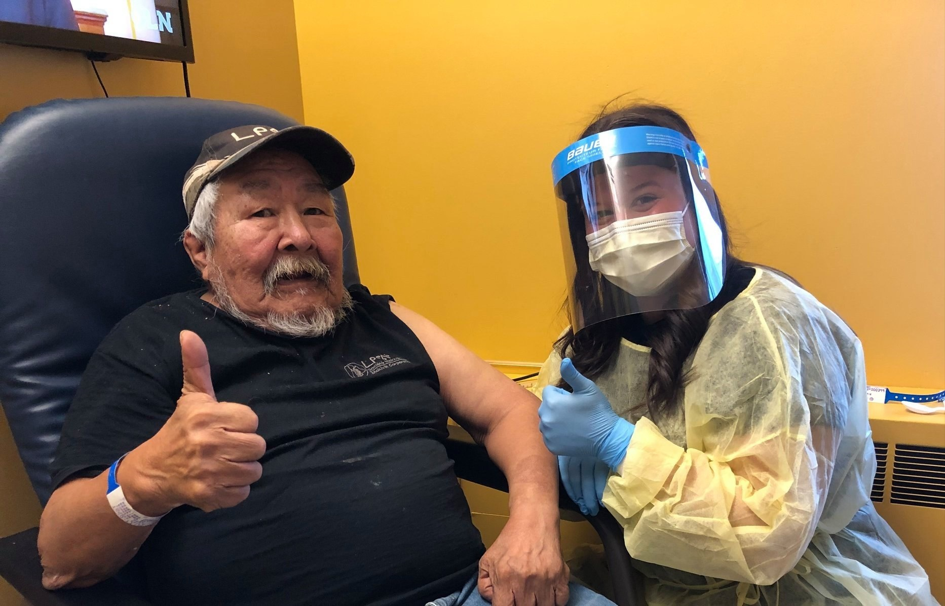 James Novalinga, 70, was the first resident of Puvirnituq to receive the COVID-19 vaccine Jan. 21, administered by nurse Vanessa Asfar at the Inuulitsivik health centre. Last week, Nunavik communities received a portion of the 1,000 shots of Moderna's vaccine shipped to the region. As of Jan. 25, the Nunavik Regional Board of Health and Social Services says 568 people have been immunized. Roughly 85 per cent of those have gone to residents aged 55 and up, while the rest have been given to frontline workers and health-care staff. (Photo courtesy of NRBHSS)