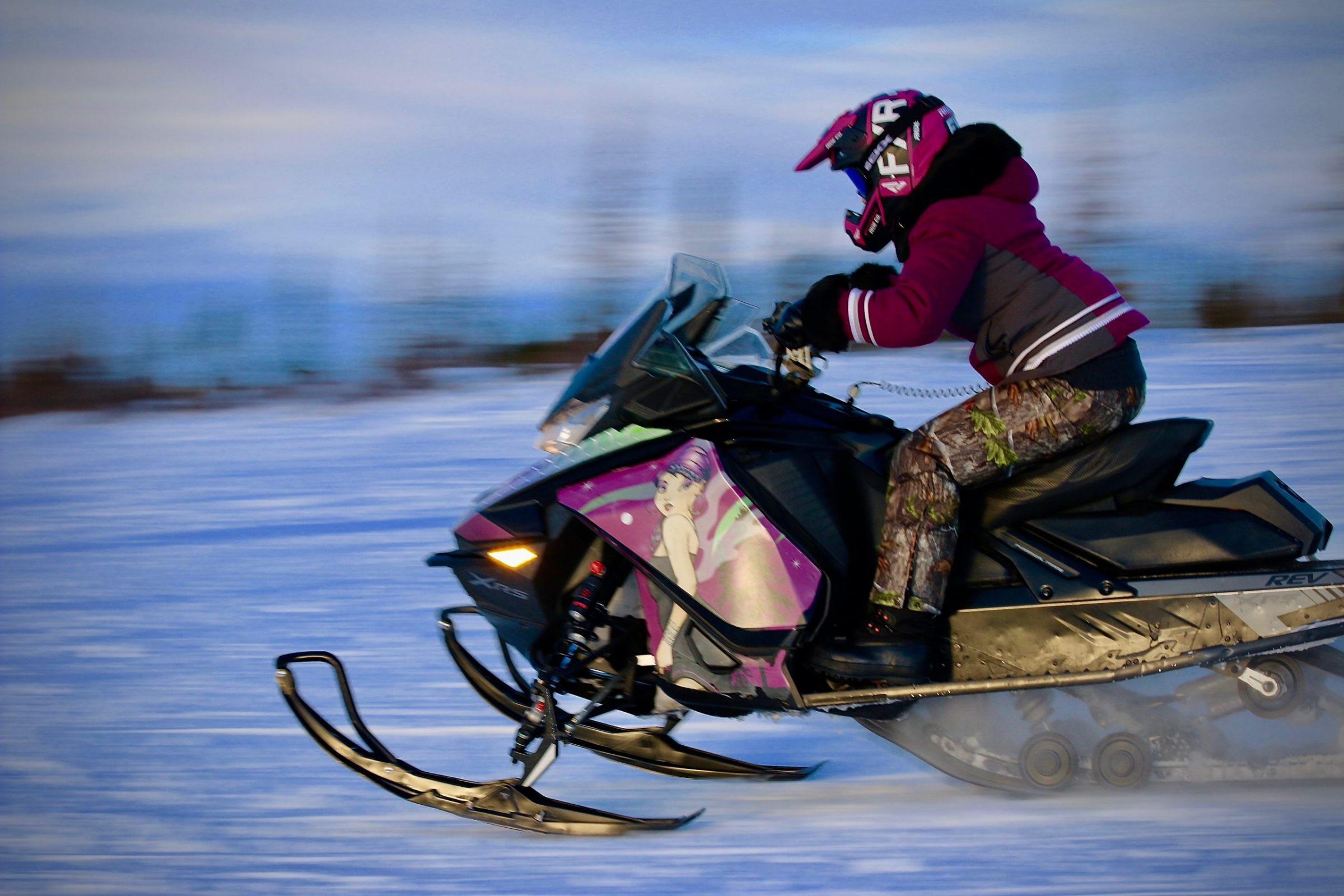 Jesse Mesher competes in snowmobile races held by the Kuujjuaq Sivulirtisait Youth Committee Jan. 10. She ended up placing third among six racers. (Photo by Malaya Qaunirq Chapman)