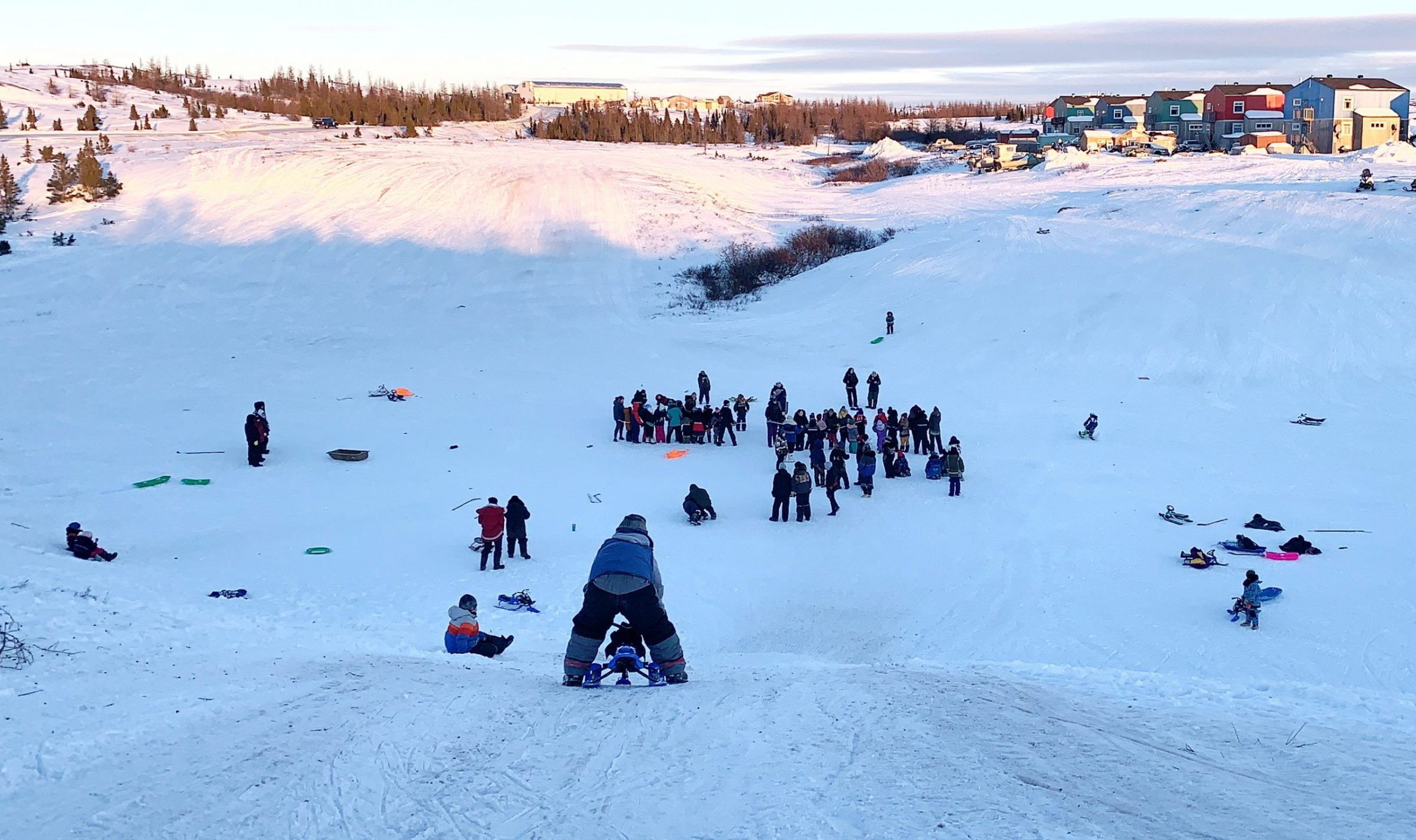 """Kuujjuaq children gathered Dec. 30 to toboggan and play games like tug-of-war organized by the northern village's education committee. """"It was beautiful to witness many kids have fun and laugh,"""" said committee member Lavinia Flaherty. (Photo by Malaya Qaunirq Chapman)"""