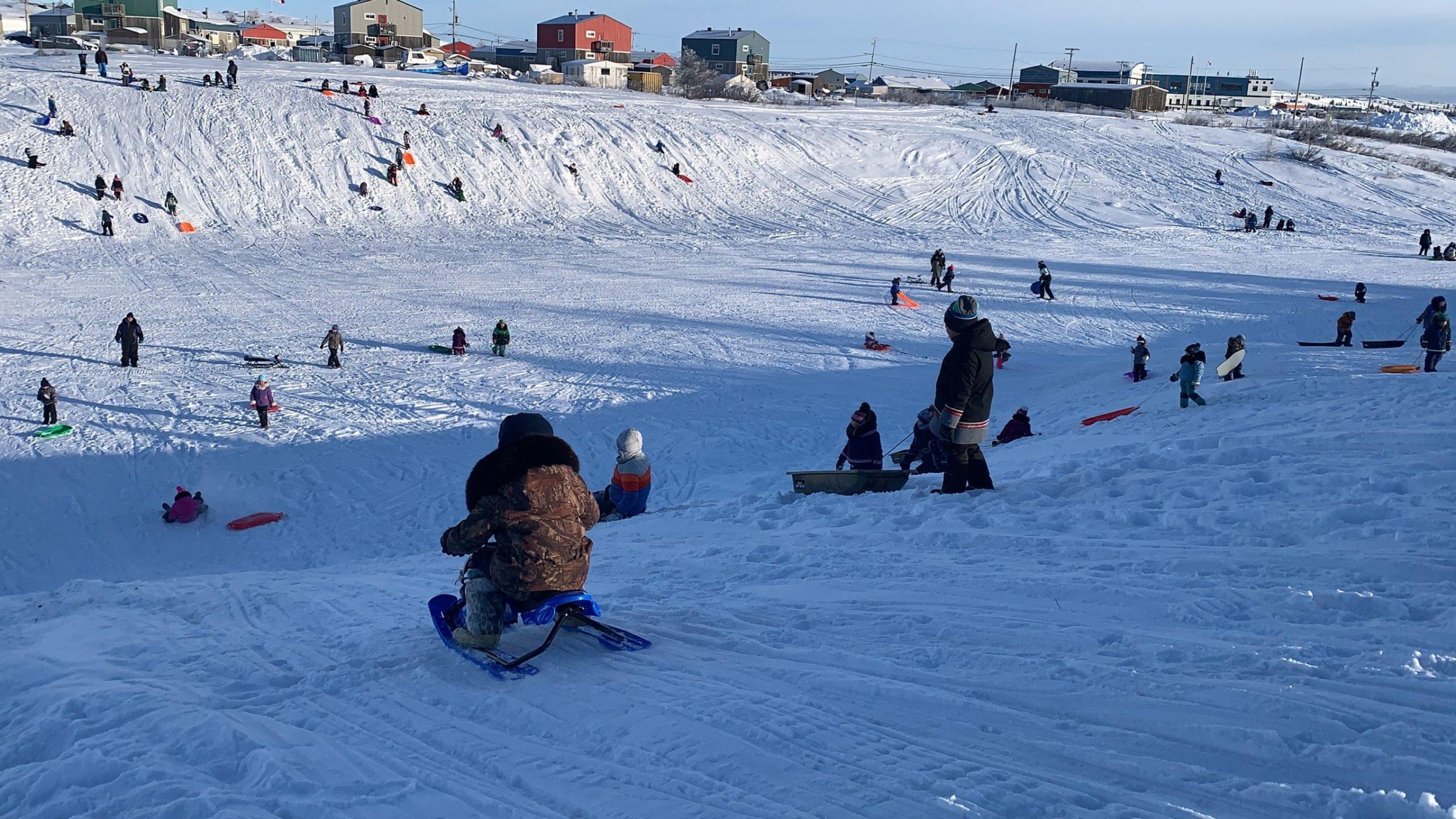 Kuujjuaq children flock to a popular sledding hill Jan. 29. (Photo by Malaya Qaunirq Chapman)