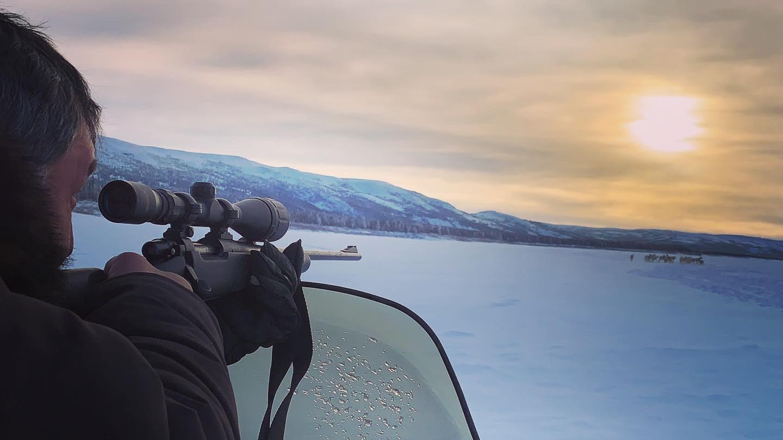 Etua Snowball takes aim at a caribou herd on Jan. 30, 190 kilometres up river from Kuujjuaq. (Photo by Malaya Qaunirq Chapman)
