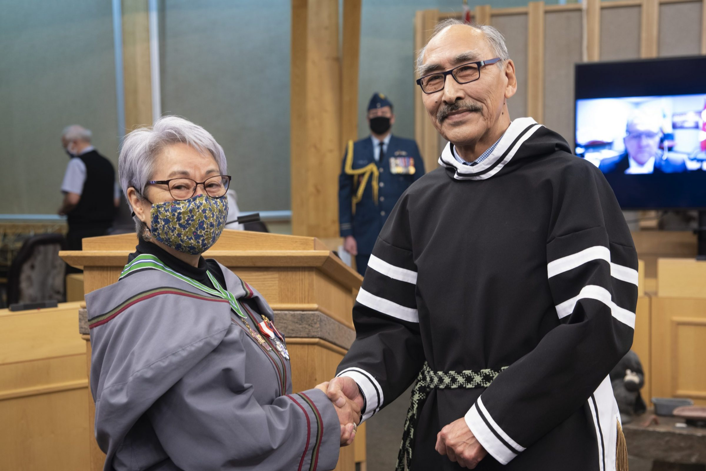 Eva Aariak is congratulated by Speaker Paul Quassa after being sworn in as the sixth commissioner of Nunavut during a ceremony inside the territorial legislature Wednesday. Aariak was also awarded with the Order of Nunavut during the ceremony. Attendees included Premier Joe Savikataaq, Nunavut Chief Justice Neil Sharkey and, by video-conference, Dan Vandal, the federal minister of northern affairs. (Photo courtesy of Michel Albert)
