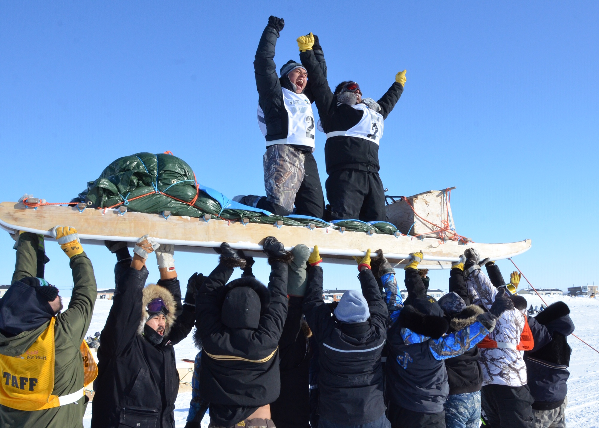Puvirnituq's Aisa Surusilak, right, and Paulusi Amarualik are hoisted into the air after winning this year's Ivakkak dog sled race on Wednesday. The team completed this year's route, from Salluit to Ivujivik, Akulivik and Puvirnituq, in 39 hours and 30 minutes, after enduring blizzards, soft snow conditions and cold winds. (Photo by Isabelle Dubois)
