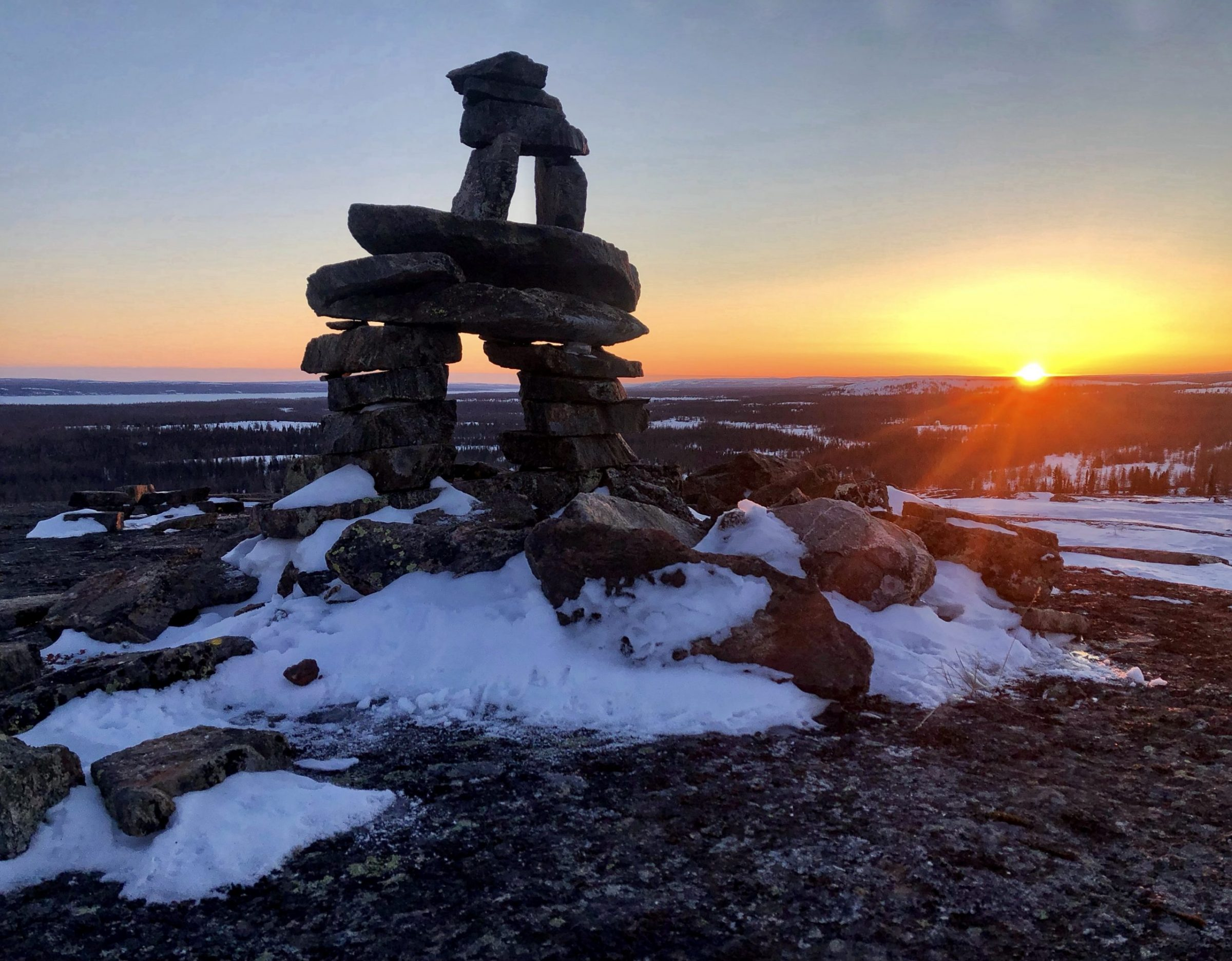 "Isabelle Dubois captured this image of an inuksuk near the Range neighbourhood of Kuujjuaq on Saturday, March 20, the first day of spring. ""Now that we have moved the time forward, it's definitely nice to enjoy longer days, with beautiful sunsets like this one,"" she wrote. (Photo by Isabelle Dubois)"
