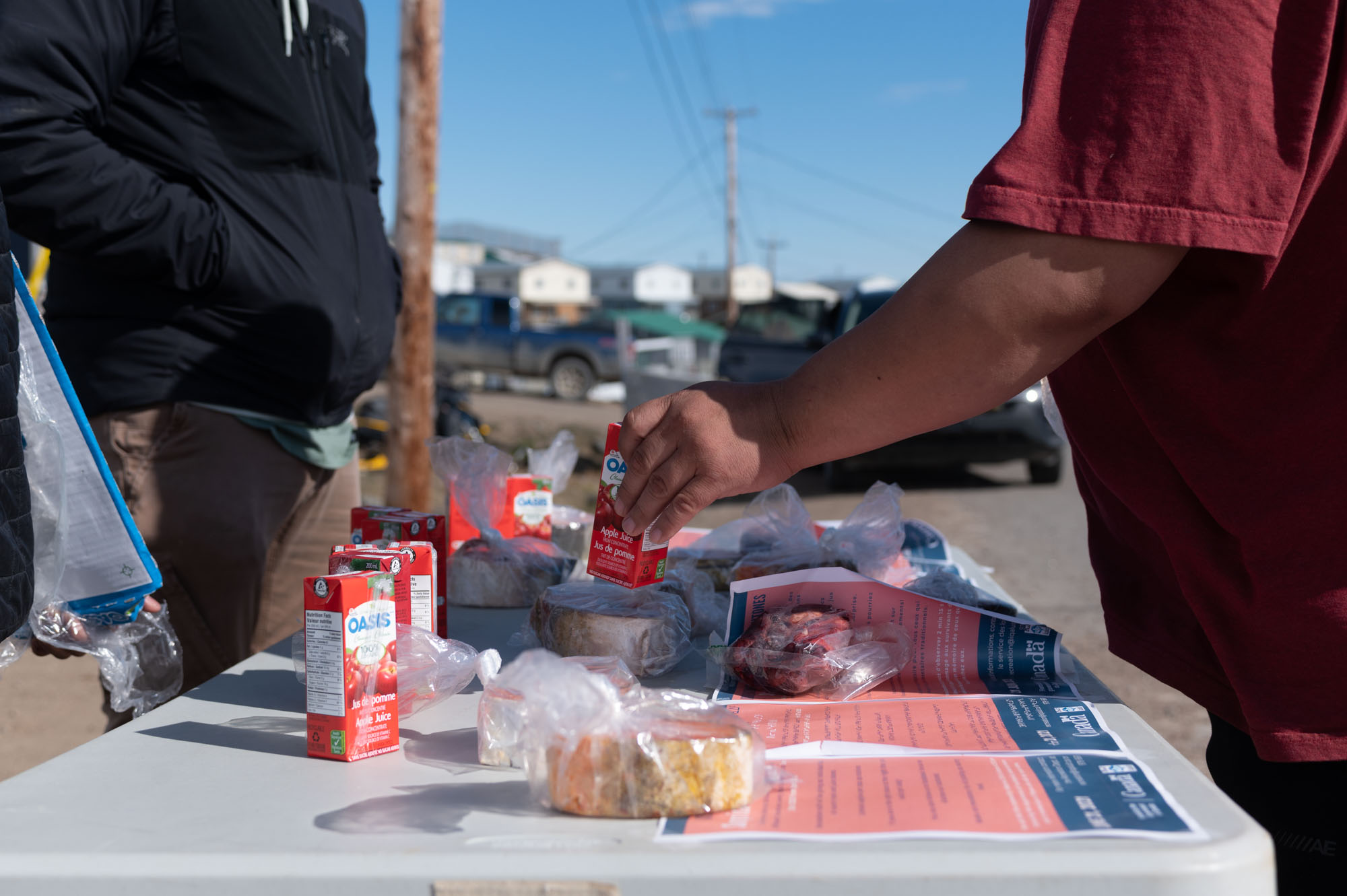 To celebrate National Indigenous Peoples Day on Monday, the City of Iqaluit's recreation department spent the afternoon distributing country food, including Arctic char and other meats, as well as juice boxes across the city. The popular pop-ups often lasted between 10 and 15 minutes before the country food was snapped up. (Photo by Dustin Patar)