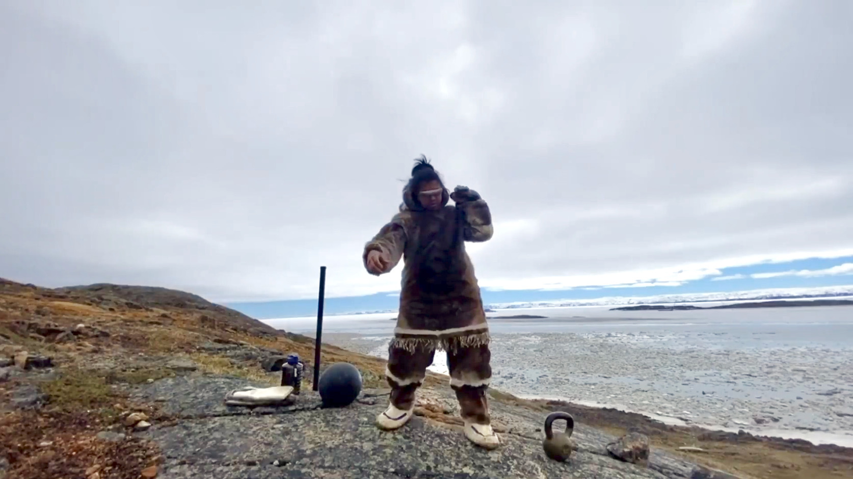 """Iqaluit's Joe Juralak added caribou-hide clothing to his workout routine over the weekend for National Indigenous History month, which is celebrated throughout June. Juralak, a self-described """"fitness freak,"""" regularly posts workout videos on Facebook and on Instagram, where he goes by @inukfit. He says exercising in the traditional clothing was hot but brought him happiness, and he hopes to come up with new ways to keep his workouts interesting in the coming weeks. (Photo provided by Joe Juralak)"""