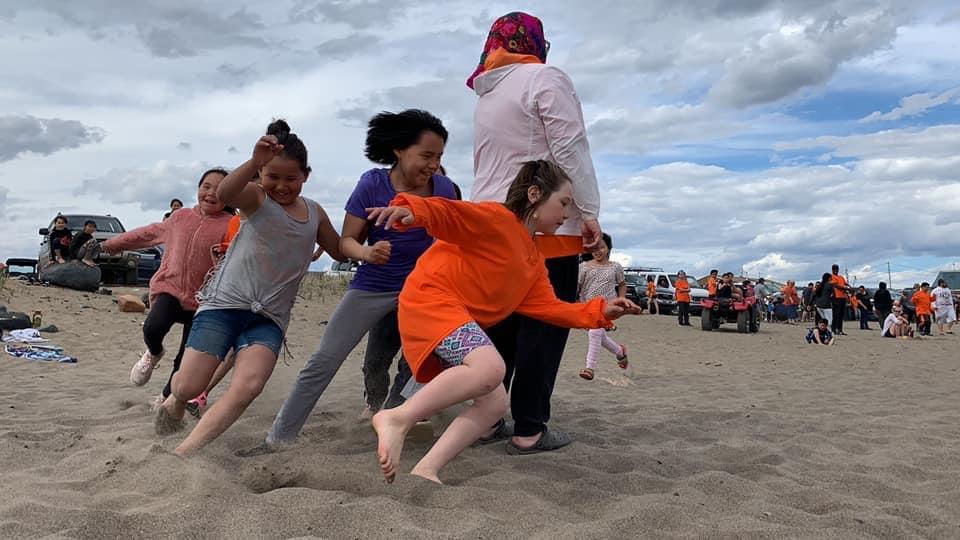 Kids race on the beach near Kuujjuaq during National Indigenous Peoples Day festivities on Monday. (Photo by Malaya Qaunirq Chapman)