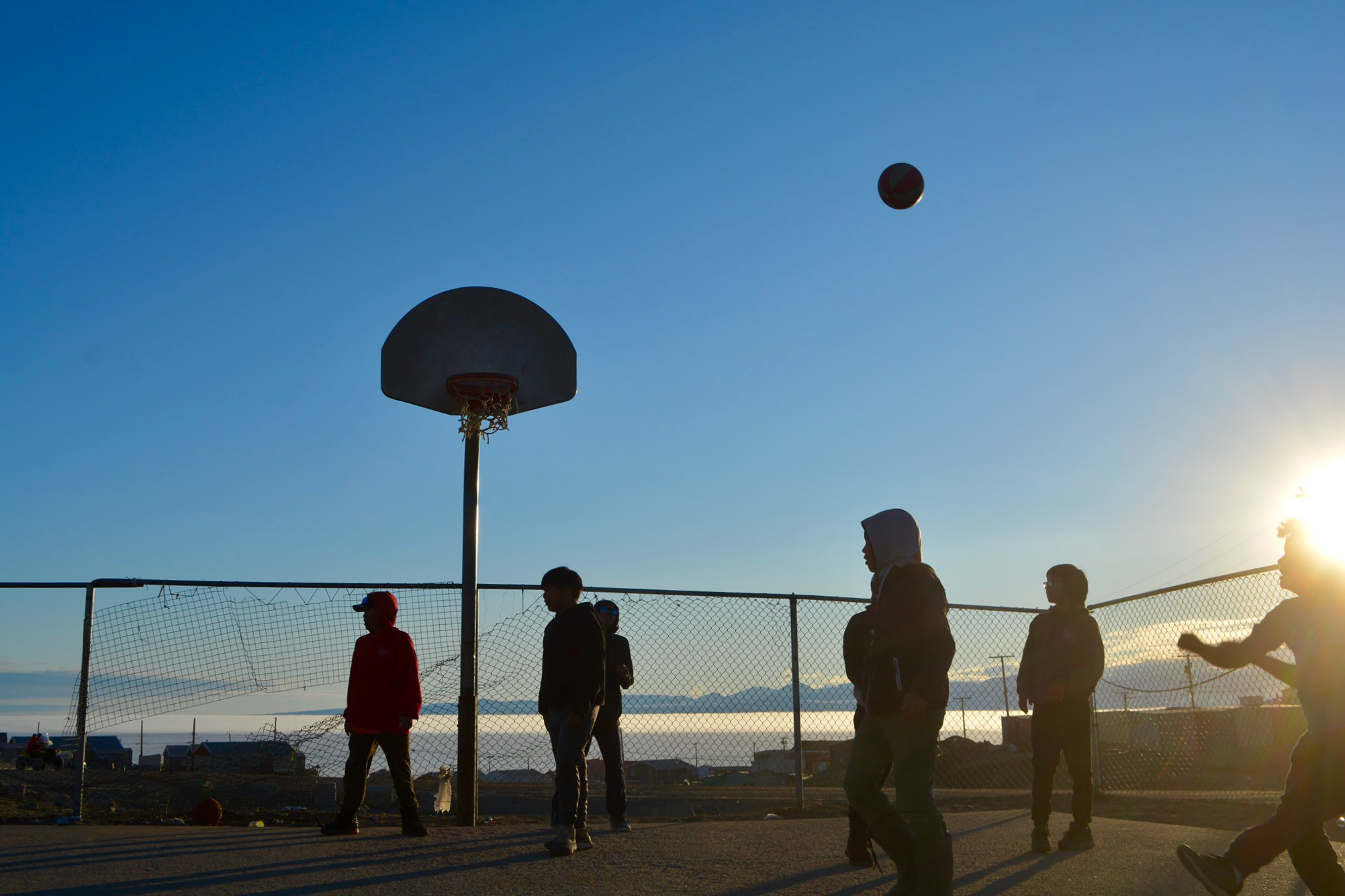 Children in Pond Inlet took advantage of the long daylight hours to play basketball in the midnight sun over the weekend. As of Sunday — the summer solstice — the days will keep getting shorter in Nunavut over the coming months. (Photo by Norman Koonoo)