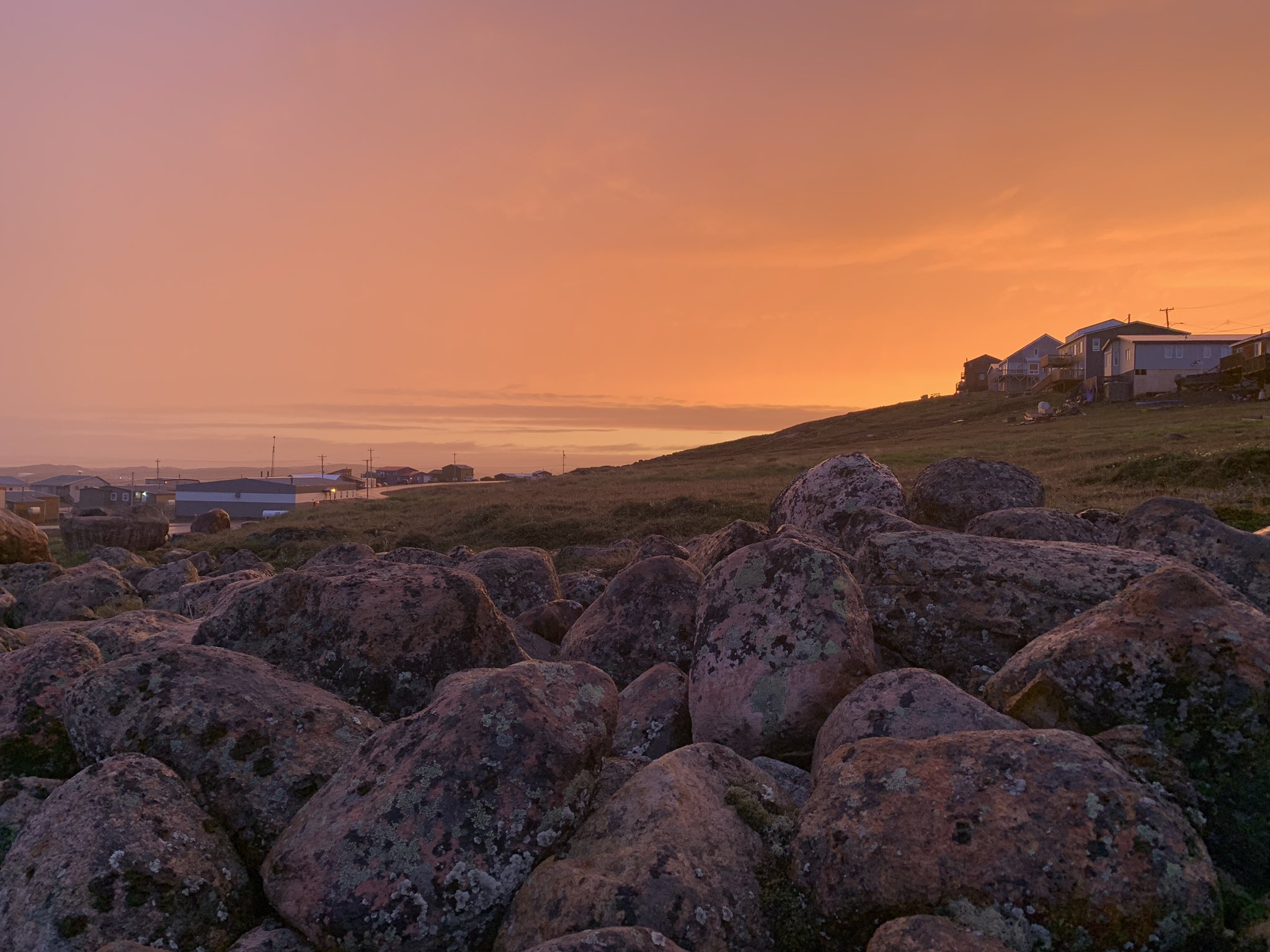 Iqaluit's Tundra Ridge neighbourhood is bathed in golden light during sunset July 13. (Photo by Frank Reardon)