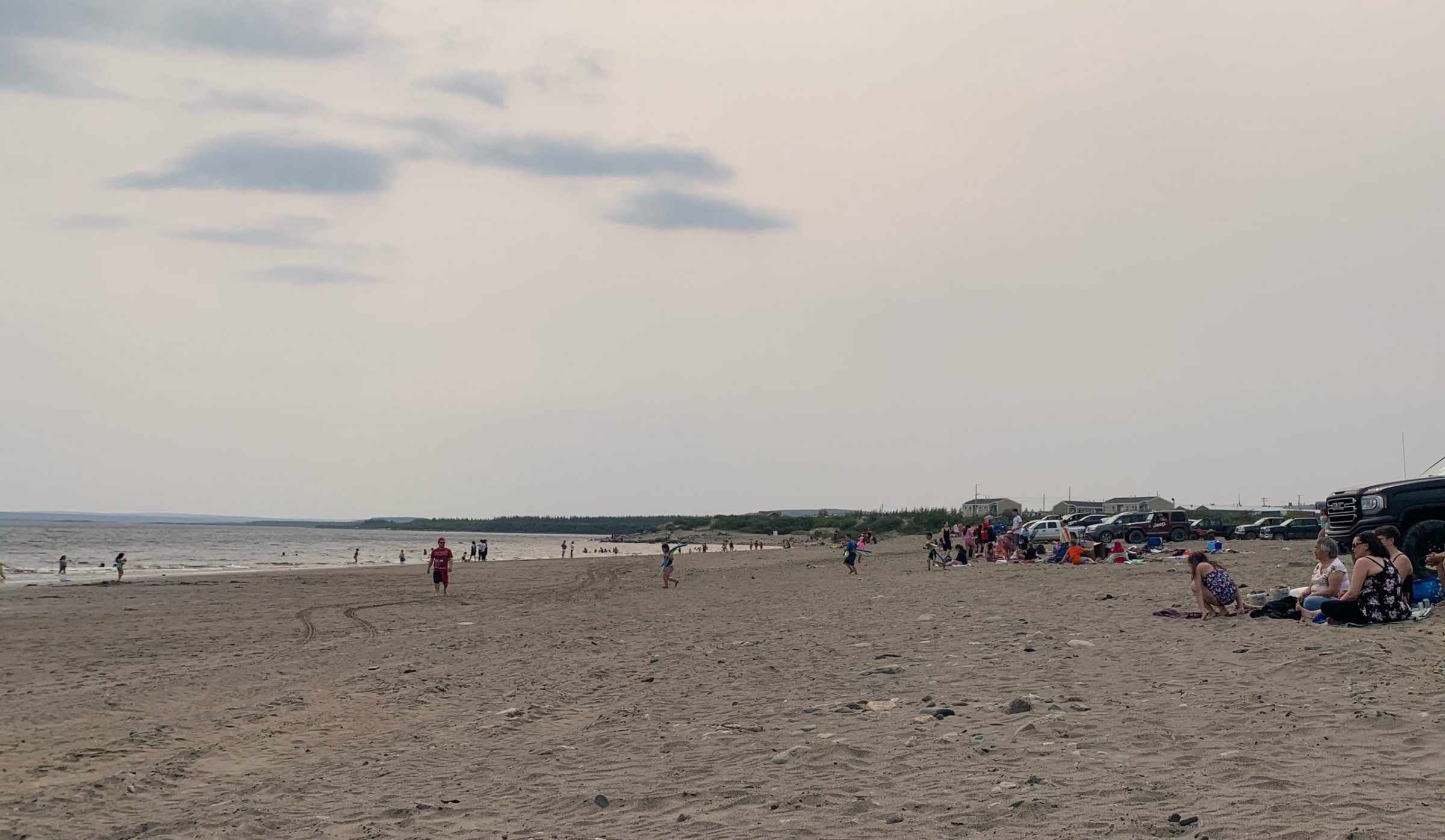 """Kuujjuaq residents hit the beach on Tuesday to cool down as temperatures reached 29 C. """"So many excited kids and their families cool down at the beach and play,"""" writes Malaya Qaunirq Chapman. (Photo by Malaya Qaunirq Chapman)"""