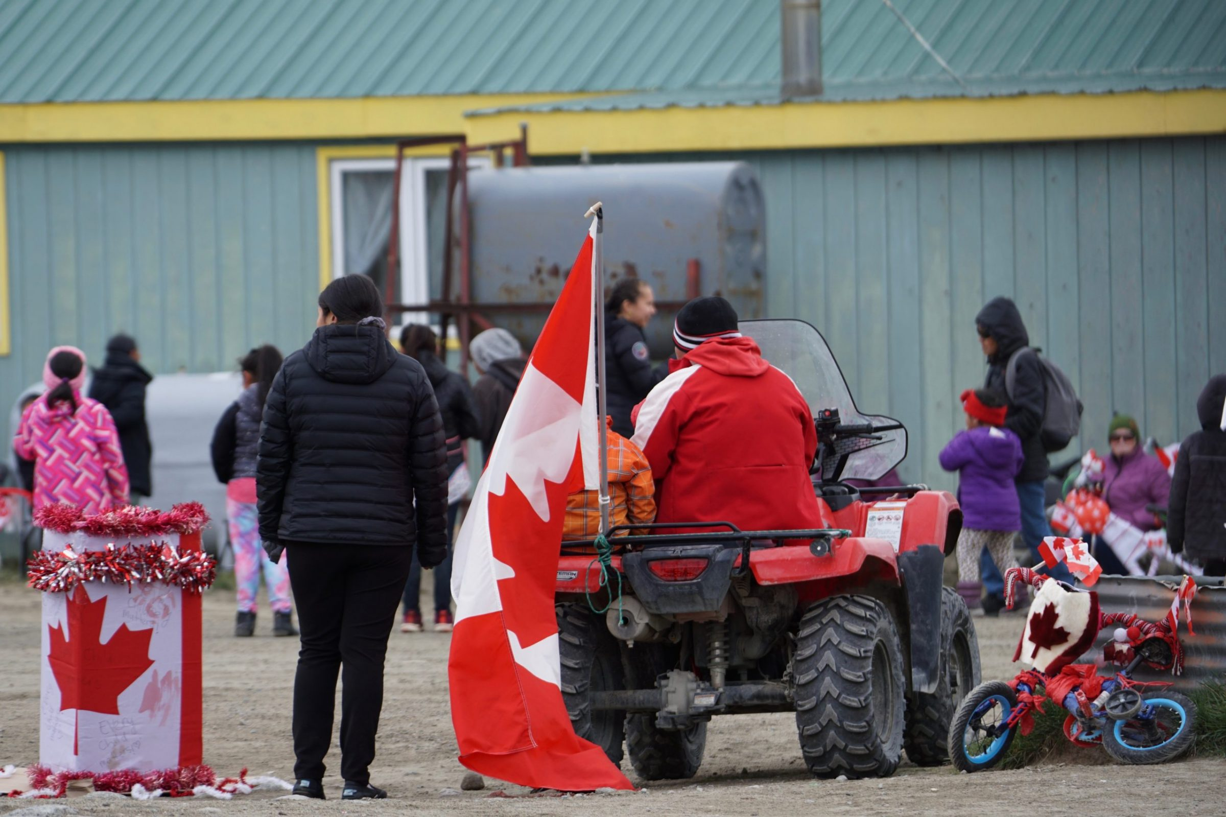 Pangnirtung residents gather to celebrate Canada Day on Thursday. Festivities included a community barbecue and contests for bike decorations and crazy hats. (Photo by Cedric Yves Denis)