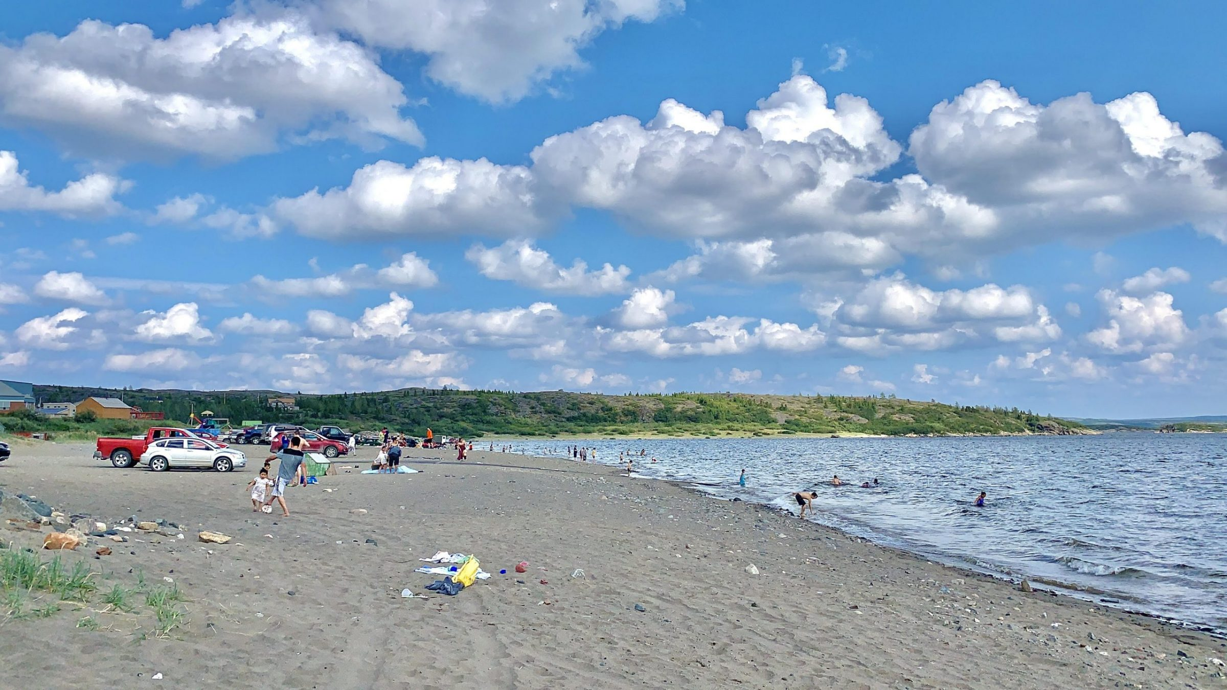 Temperatures in Kuujjuaq reached 28 C on Thursday with the humidex making it feel like 34 C, so community members retreated to the Kuujjuaq beach to cool down. (Photo by Malaya Qaunirq Chapman)
