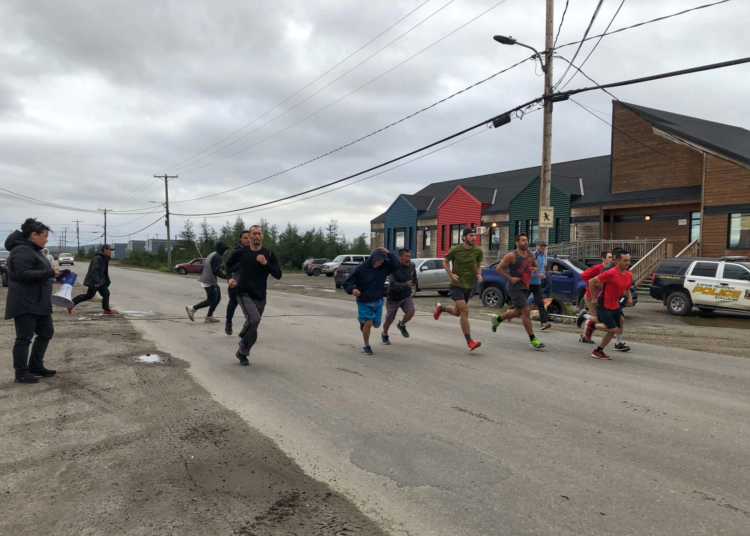 Kuujjuaq residents take part in a race organized by the local recreation committee on Monday, Aug. 16. The route ran just over 10 kilometres, from the Tumiapiit Daycare to the fork in the roads leading to the marina and back. Albert Roy took the top prize for men under-39, with a time of 45 minutes and 40 seconds. Nicolas Gauthier won the men's over-40 category, with 54 minutes and 20 seconds. Tusaajiapik Imbeault won the women's under-40 category with one hour, 8 minutes and 23 seconds. And Isabelle Dubois won the women's over-50 category with one hour, 19 minutes and 32 seconds. The winners of each category received $500. (Photo by Isabelle Dubois)