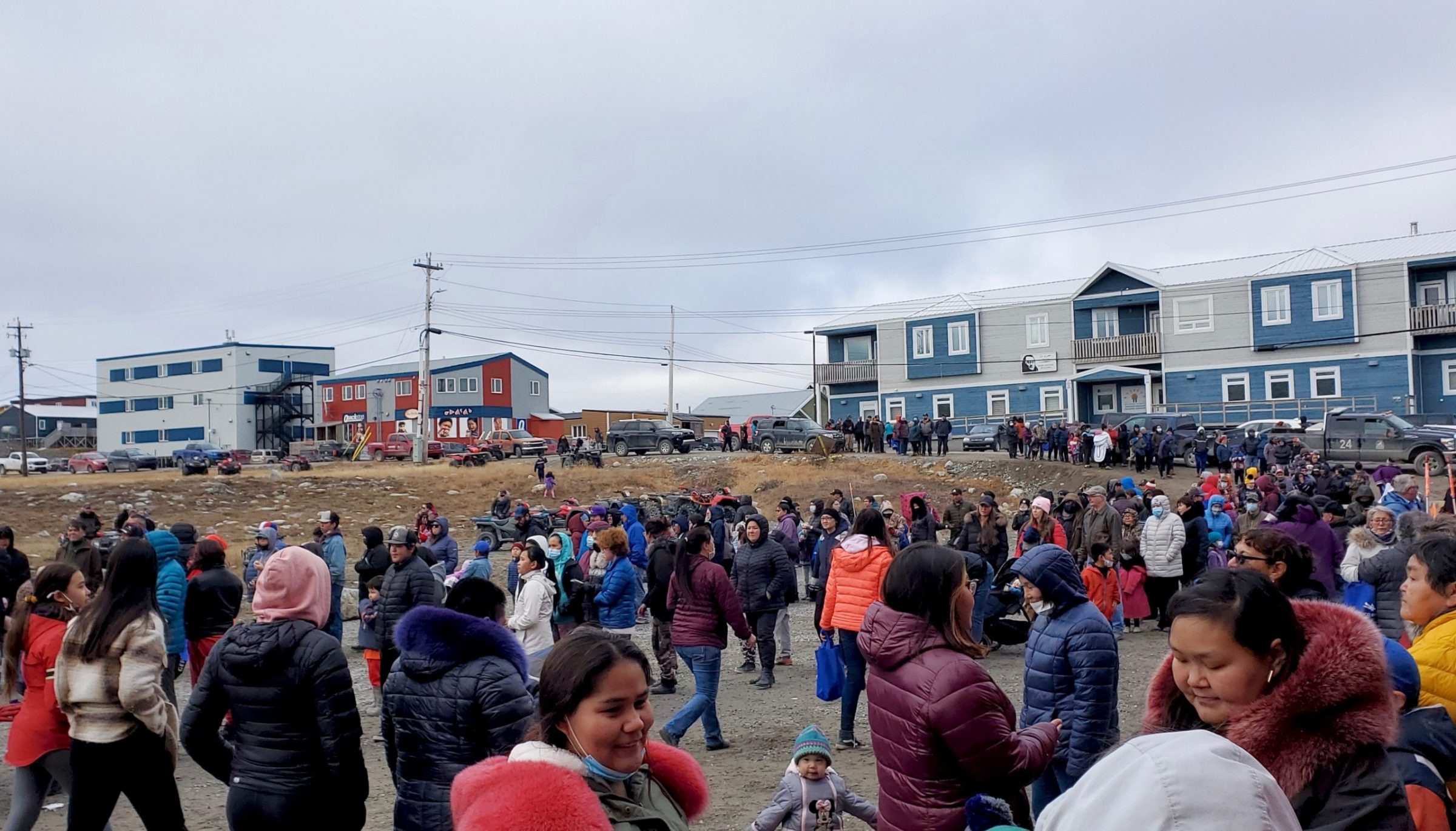 Hundreds of Rankin Inlet residents gather at an arena-naming ceremony on Wednesday. Darren Flynn, the hamlet's senior administrative officer, said the event, which included a community barbecue, bouncy houses and over $30,000 in prizes to be won — like an ATV — exceeded expectations. The arena was named Agnico Eagle Arena, after the mining company that has signed a 10-year agreement to contribute $50,000 annually to the hamlet, Flynn said. (Photo by Pam Simons)