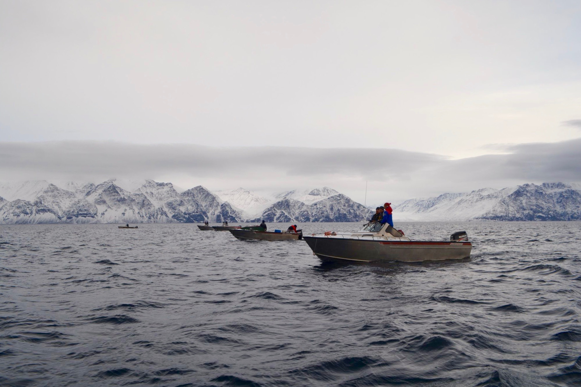 Two dozen boats from Pond Inlet with snow on their bows were on the water Sept. 22 and 23. The group of hunters harvested three or four narwhals during that time, estimated Norman Koonoo, who was on one of the boats. (Photo by Norman Koonoo)