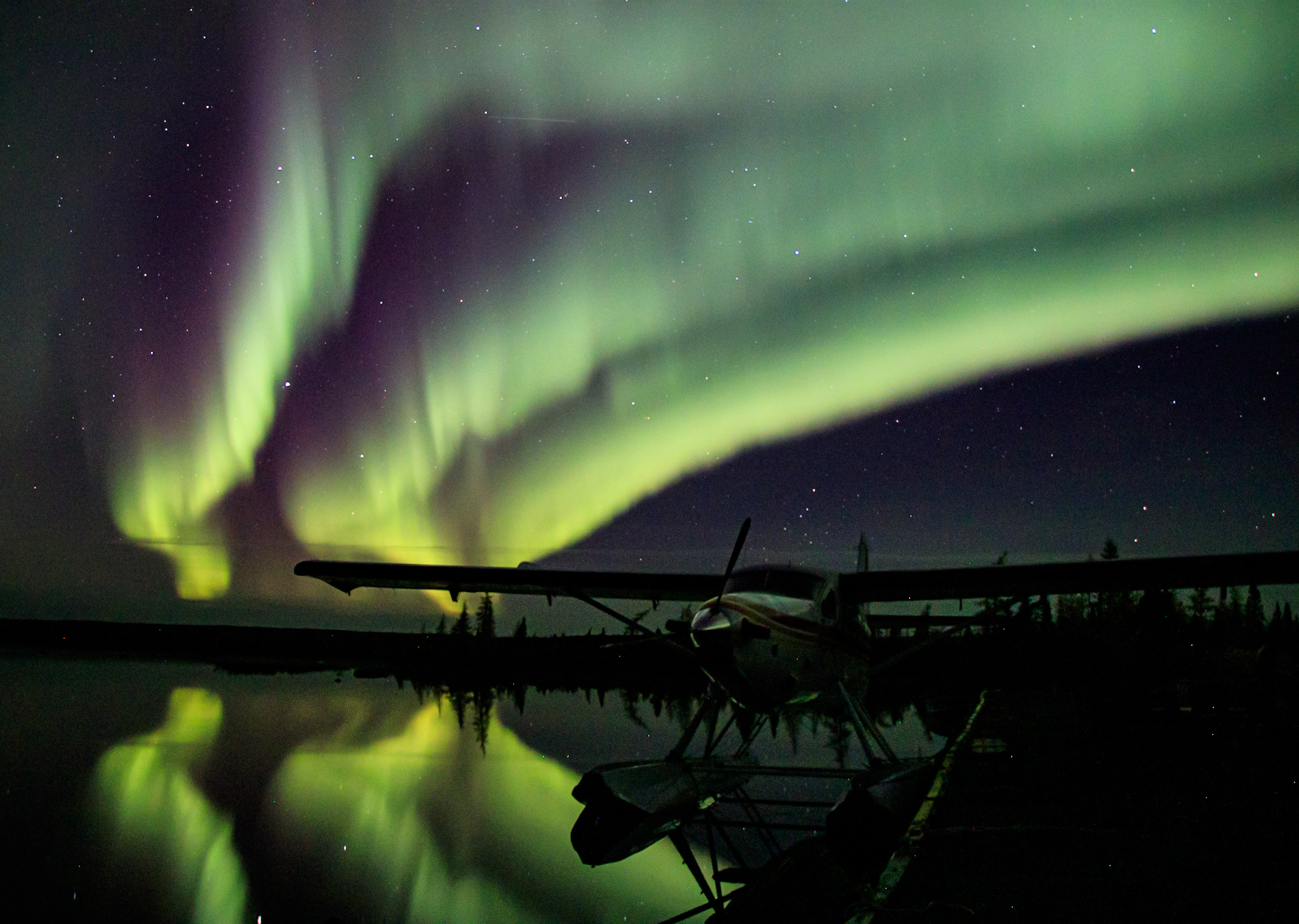 The northern lights glow over Kuujjuaq on Sunday, Oct. 3. In the foreground is the Pengo Pally, the floatplane of legendary Inuit bush pilot Johnny May. (Photo by Maxence Chavanne)