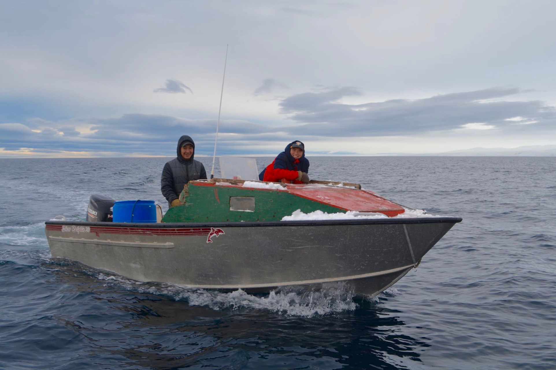 Pond Inlet brothers Lee Inuarak, left, and Michael Inuarak set out in one of two dozen boats that took part in a community narwhal hunt on Sept 22 and 23. (Photo by Norman Koonoo)